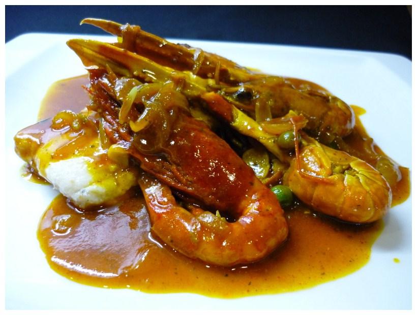 A Tu Gusto en Valencia Merluza con salsa de marisco