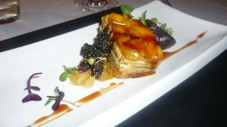 Millefeuille of foie gras, goat cheese and mango with pickled ginger, caramelized fig and black sesame